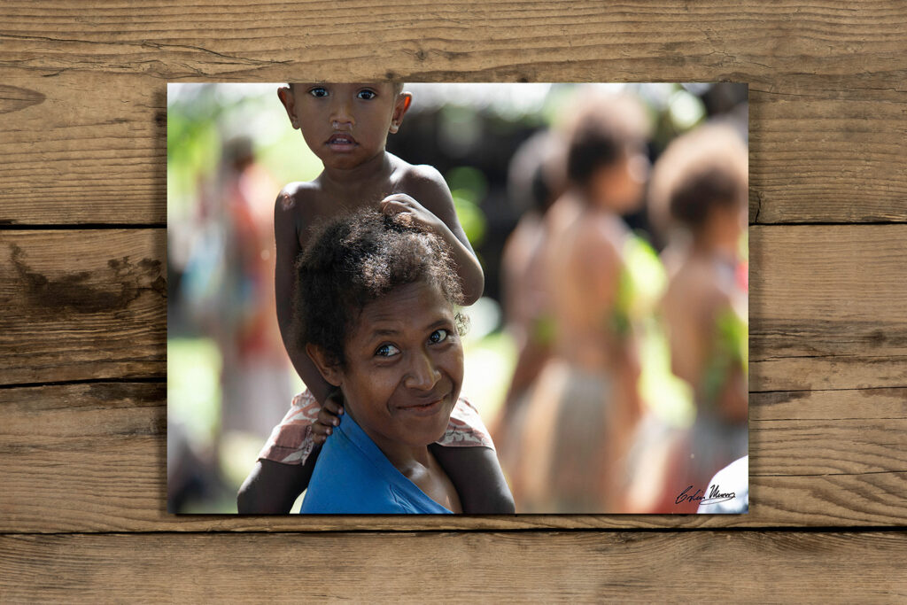 A mother and son turn to smile and regard me with curiosity.  Fergusson Island, Milne Bay, Papua New Guinea. Art acrylic facemount print. www.colinmunrophotography.com